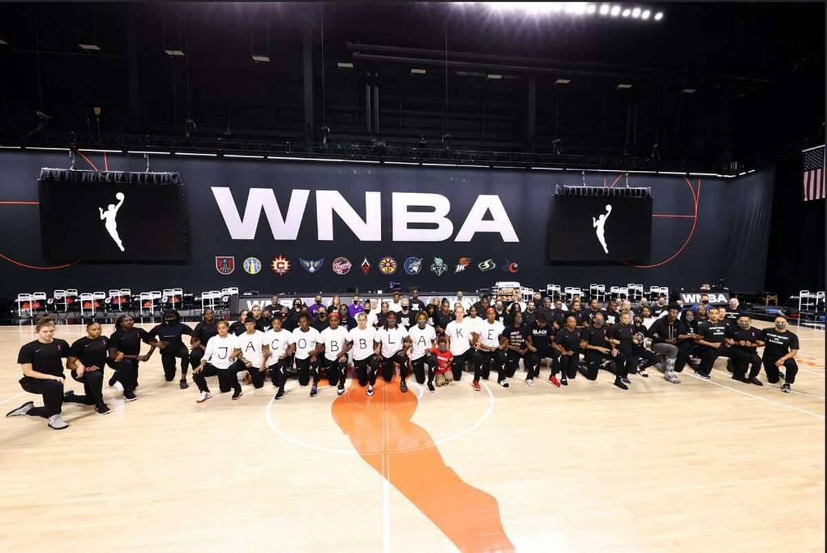 WNBA players show solidarity during protests that forced the postponement of six games over two days.