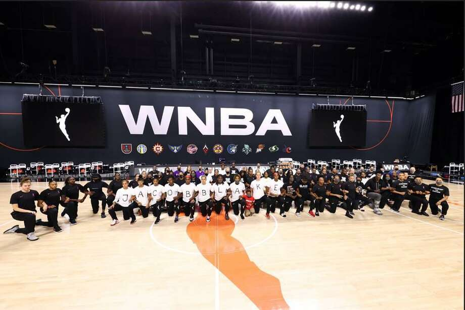 WNBA players show solidarity during protests that forced the postponement of six games over two days. Photo: Contributed Photo / WNBA