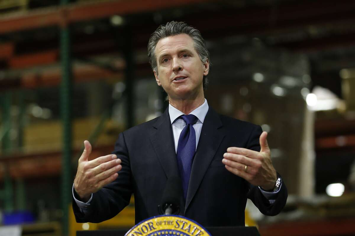 FILE - In this June 26, 2020, file photo, California Gov. Gavin Newsom speaks at a news conference on the state's response to the coronavirus outbreak in Rancho Cordova, Calif. California is poised to take another halting step toward normalcy under the coronavirus pandemic, with Gov. Newsom expected to announce plans for reopening businesses that were shuttered nearly two months ago after cases subsided, then soared again. (AP Photo/Rich Pedroncelli, Pool, File)