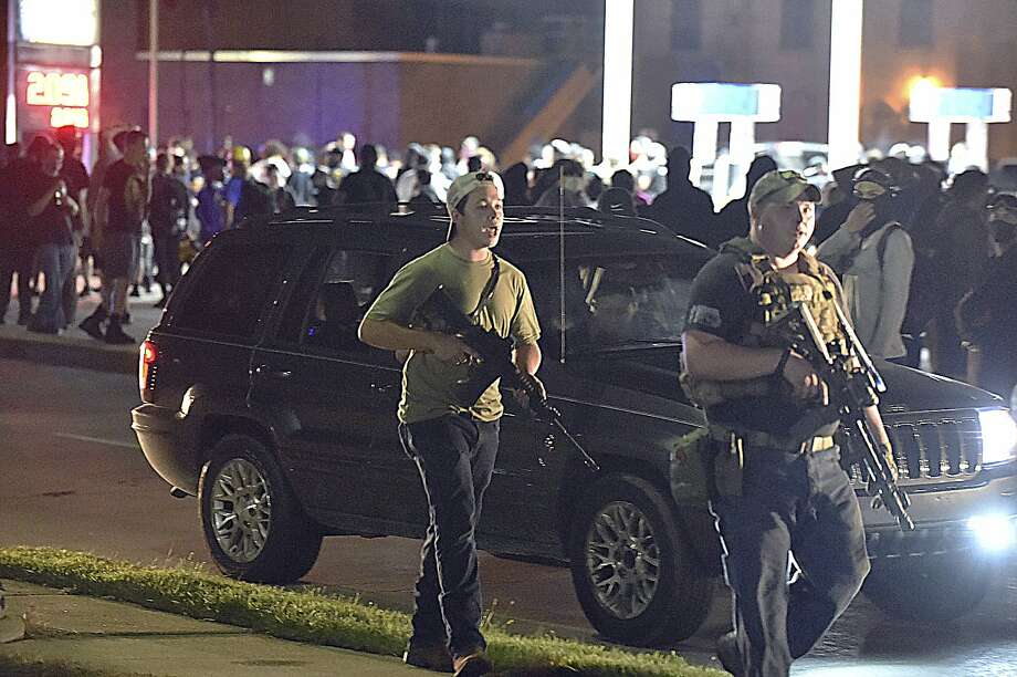 Seventeen-year-old Kyle Rittenhouse (left) is accused of killing two in Kenosha, Wis., during demonstrations after the police shooting of a Black man. Photo: Adam Rogan / Racine (Wis.) Journal Times