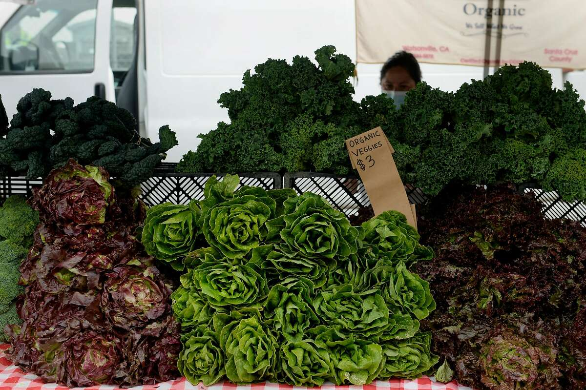 Colorful, organic produce is displayed at the Ferry Plaza Farmers Market on Saturday, August 8, 2020, in San Francisco, Calif. Many vendors and shoppers prepare ahead of time on market day to not use the limited - and often unkept - public restrooms available in the Bay Area, especially in the midst of the coronavirus pandemic. And although there's talk of porta potties near the building, none are in place as of yet.