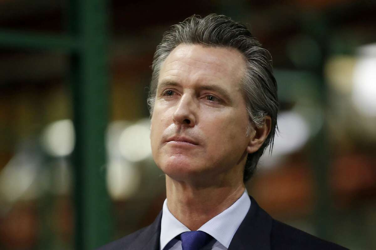 FILE - In this June 6, 2020, file photo, California Gov. Gavin Newsom listens to a reporter's question during a news conference in Rancho Cordova, Calif.