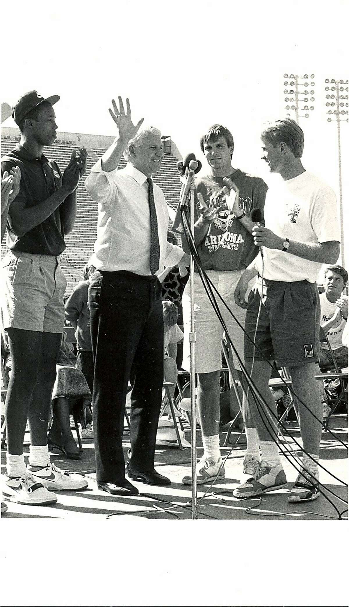 Steve Kerr and teammates stand with Lute Olson during�a rally and parade for the men's basketball team at University of Arizona stadium in Tucson, Ariz., after the 1988 NCAA Final Four.