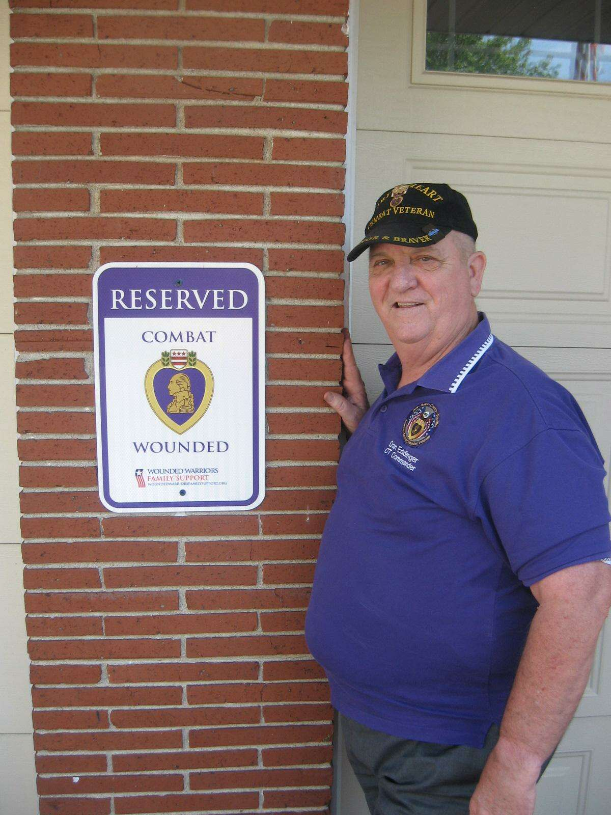 U.S. Army Major Daniel Eddinger (Ret), shows the honorary parking space at Torrington City Hall, reserved for recipients of the Purple Heart Medal.