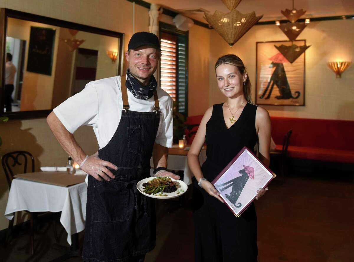Executive chef Adrien Blech his wife Maitre D' Kate Blech pose inside the new Orienta restaurant in Greenwich, Conn. Tuesday, Aug. 25, 2020. Located at 55 Lewis St., the French-Vientamese bistro features a creative menu from executive chef Adrien Blech.