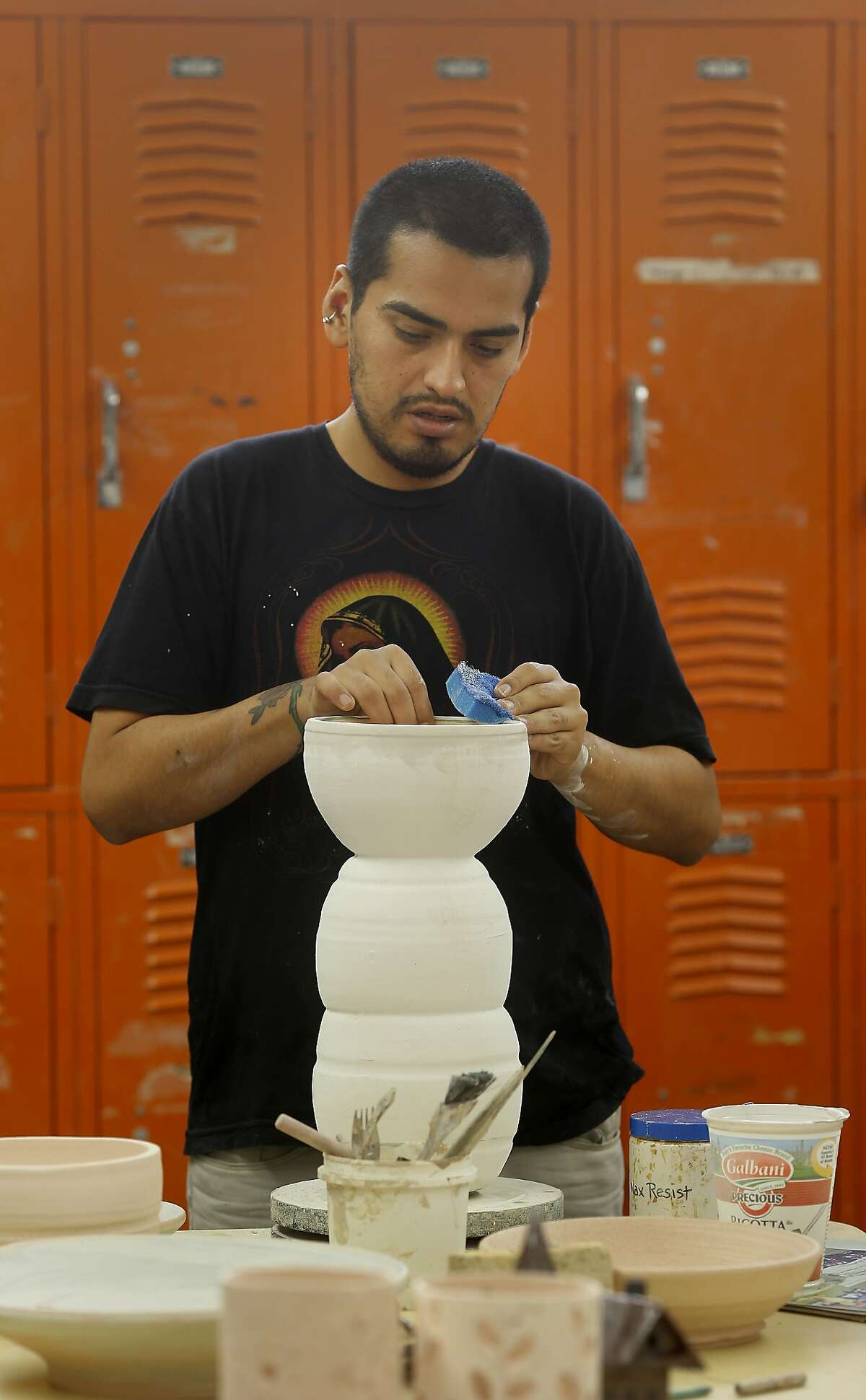 Cesar Espinoza works on his vase assignment for ceramics class at the City College of San Francisco classes at Fort Mason. Fort Mason, the 35 year old arts center in San Francisco, Calif., is thriving and growing with new displays, classes and a new lounge.