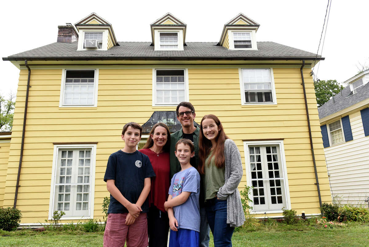Erin Tobin, second from left, stands with her husband Roger Bearden, and their children Myles Bearden, left, Eli Bearden, center, and Sarah Bearden outside their home on Thursday, Aug. 27, 2020 in Albany, N.Y. (Lori Van Buren/Times Union)