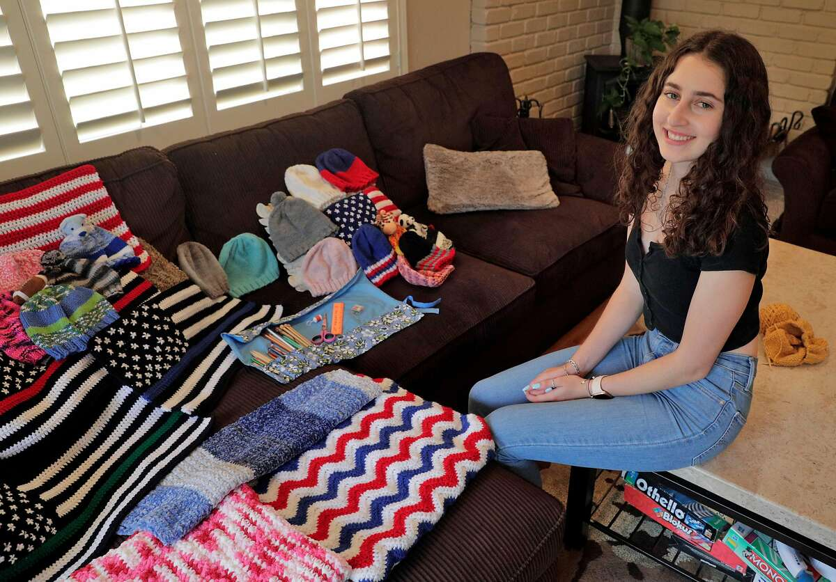 Hannah Levine, 17, has been knitting and crocheting small items for like hats, blankets, and flags for people in local hospitals since the beginning of the shelter in place at her home in San Bruno, Calif., on Monday, August 17, 2020. She is a senior in high school, and hopes to one day study for a profession in the medical realm.