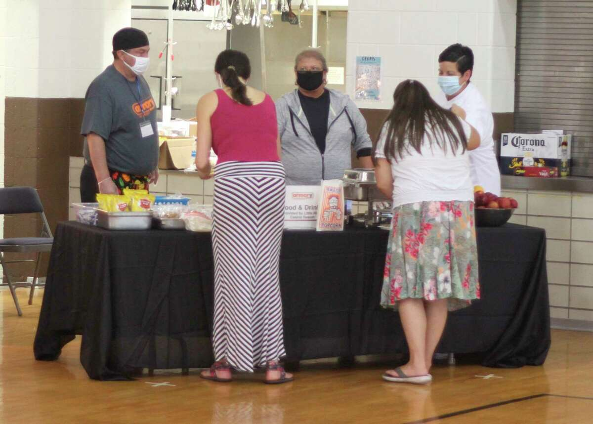 Representatives from theLittle River Casino Resort was on hand to provide hog dogs, popcorn, cookies and more to those attending the Armory Youth Project's back to school kickoff event Friday. (Kyle Kotecki/News Advocate)