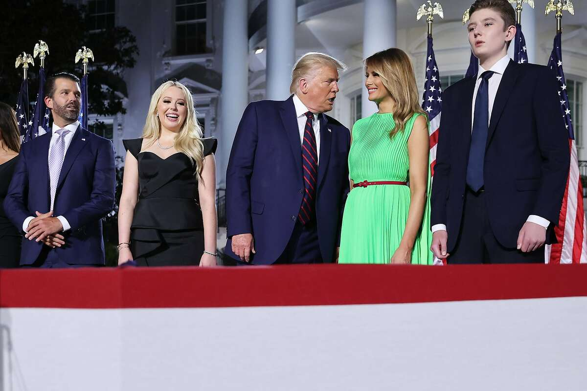 WASHINGTON, DC - AUGUST 27: U.S. President Donald Trump (C) speaks with first lady Melania Trump as they stand with family members after delivering his acceptance speech for the Republican presidential nomination on the South Lawn of the White House August 27, 2020 in Washington, DC. Trump gave the speech in front of 1500 invited guests. (Photo by Chip Somodevilla/Getty Images)