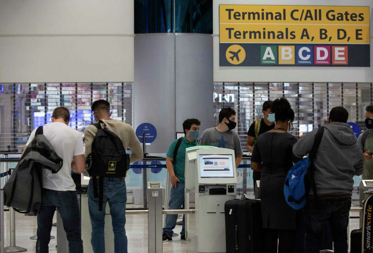 Passengers checking in Tuesday, July 7, 2020, at George Bush Intercontinental Airpo in Houston. In July, 946,000 passengers traveled through IAH, down 77 percent from 4.2 million during July 2019, according to the Houston Airport System.