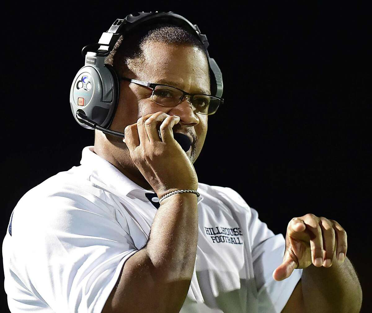 Hillhouse football coach Reggie Lytle talks to his staff from the sideline against Brookfield in 2018.