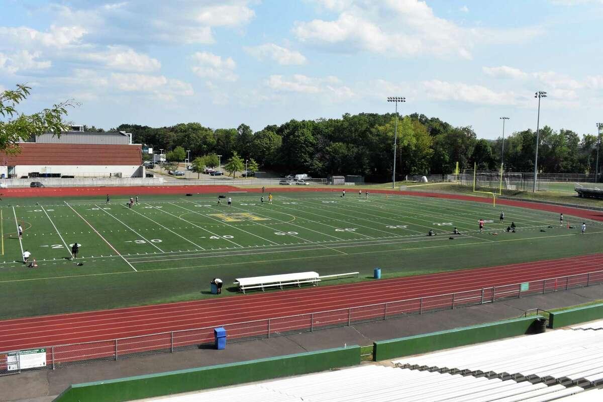 Hamden football players workout at Hamden High School in August.