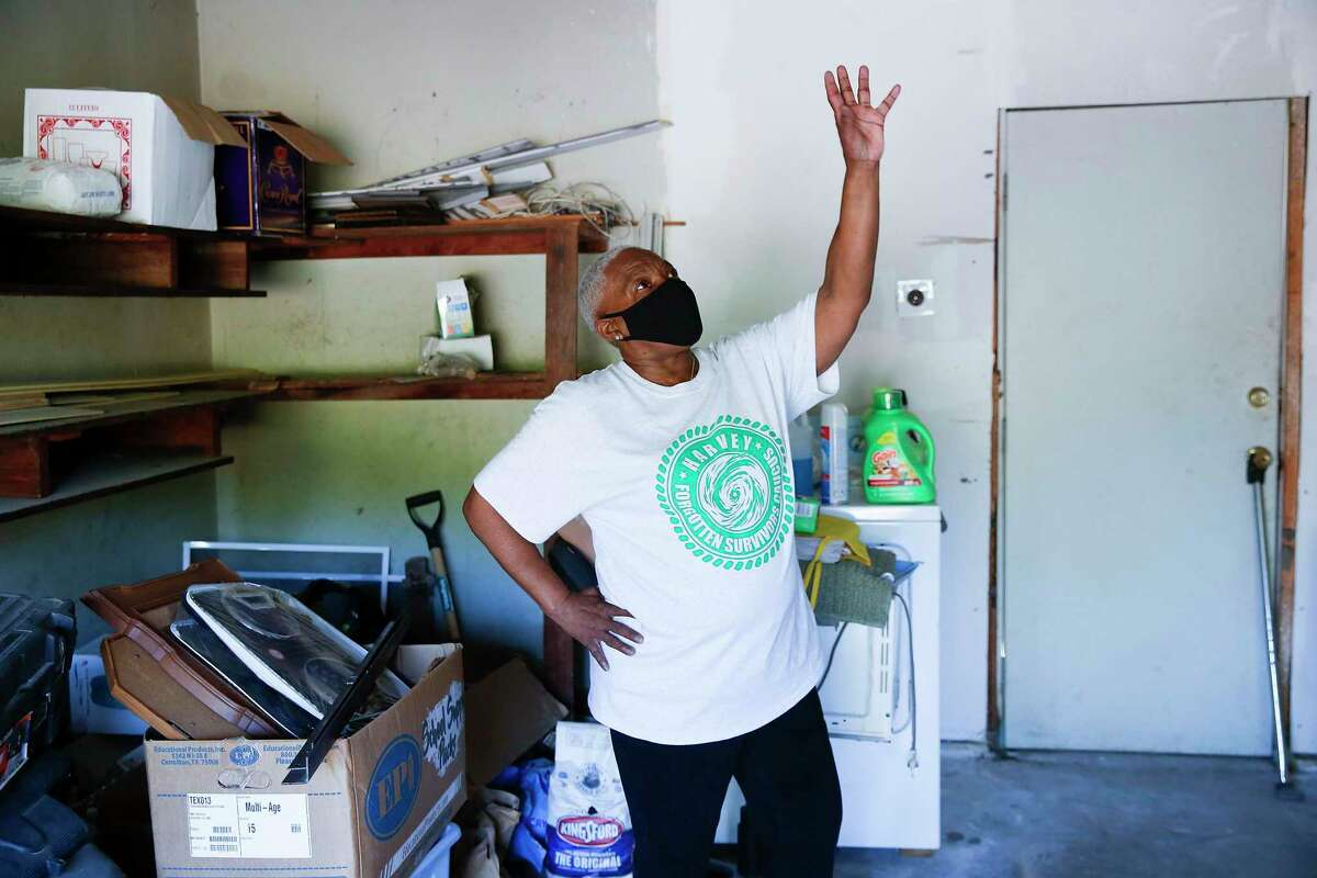 Harvey Forgotten Survivors Caucus member Doris Brown shows damage remaining in her garage from Harvey on Tuesday.