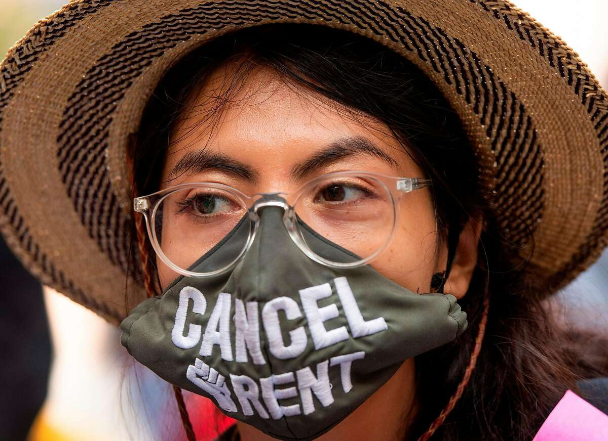 A protester wearing a mask 'Cancel Rent' attends a protest to cancel rent and avoid evictions amid Coronavirus pandemic, August 21, 2020, in Los Ageles, California. (Photo by VALERIE MACON / AFP) (Photo by VALERIE MACON/AFP via Getty Images)
