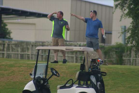 Just as these two golfers appear to be doing at The Battleground Golf Course on Friday, team members in your foursome may need help locating your ball during the Chamber of Commerce's 19th annual event Oct. 22.