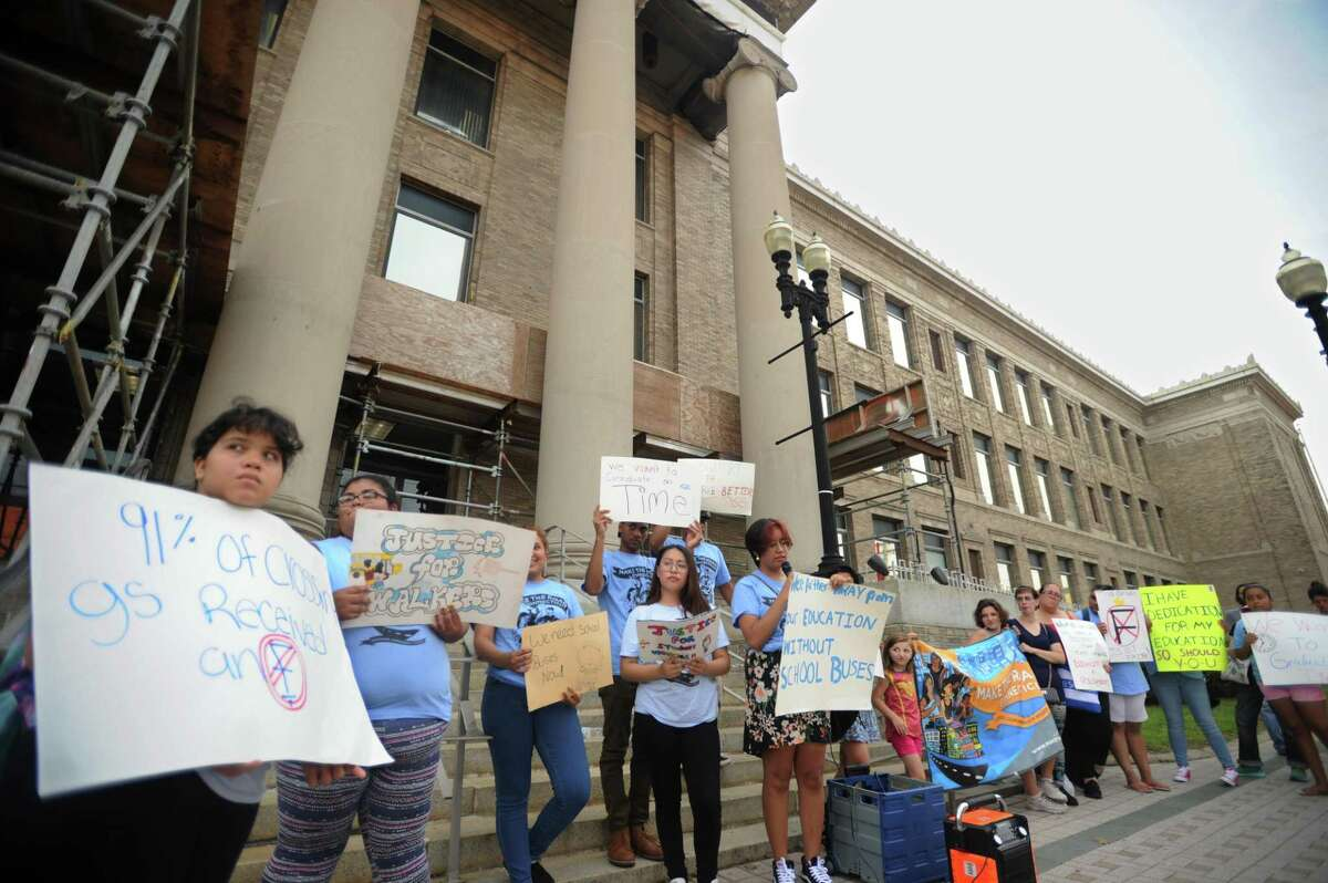 Students from Make the Road Connecticut's Youth Power Committee lead a rally for better school bus service outside City Hall in Bridgeport, Conn. on Monday, August 27, 2018.