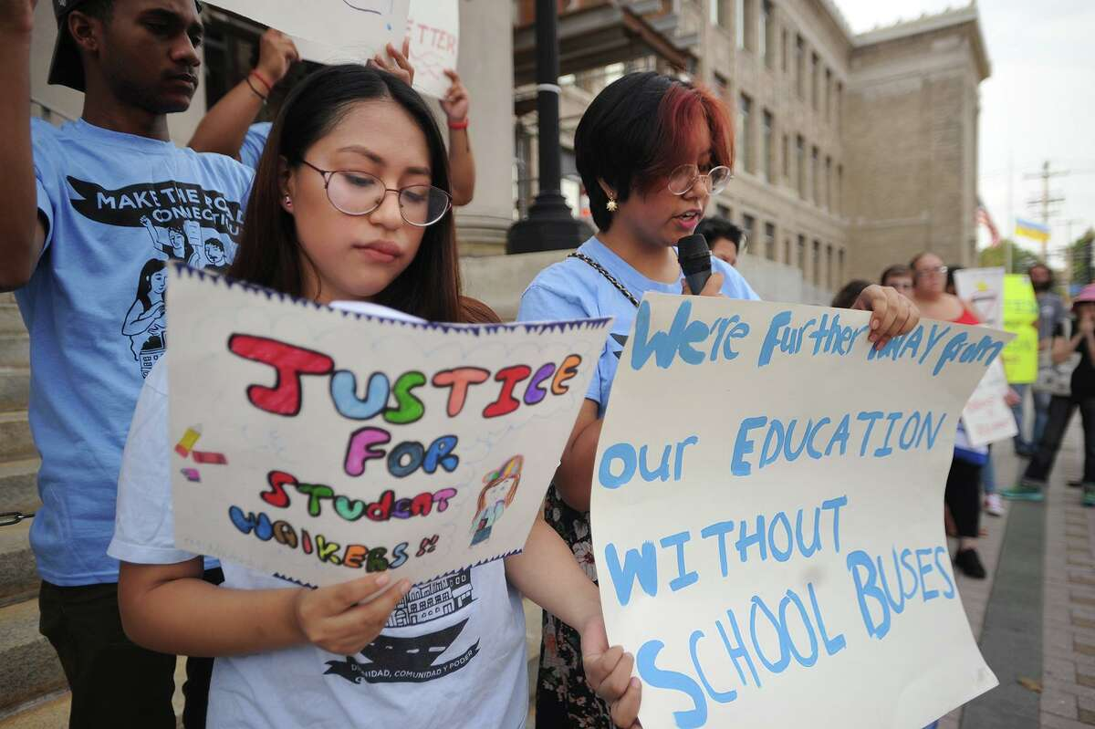 Tania Chapa, left, and Morgan Gonzalez, both 14 of Bridgeport, members of Make the Road Connecticut's Youth Power Committee, lead a rally for better school bus service outside City Hall in Bridgeport, Conn. on Monday, August 27, 2018.