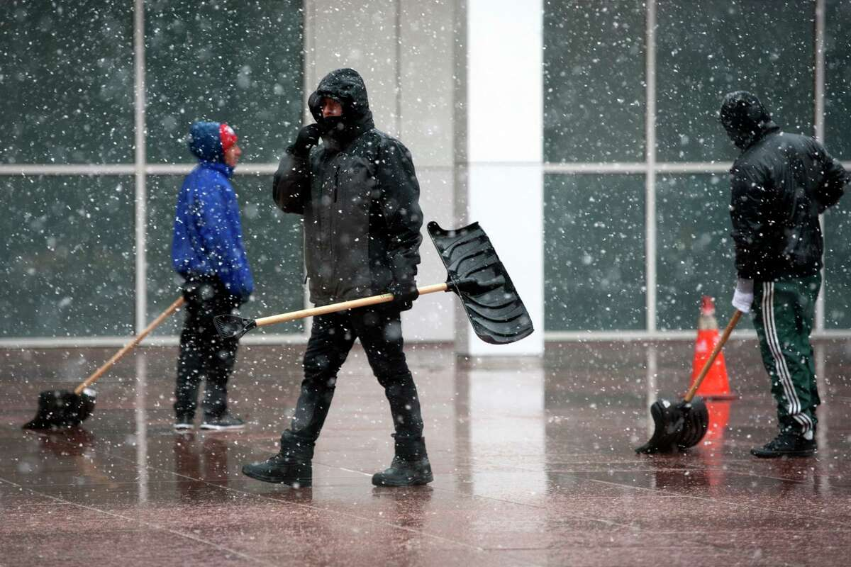 Workers prepare to clear sidewalks as the rain turns to snow along Main Street Wednesday in Bridgeport, Conn. March 7, 2018. How much snow will we get? The rain will change to snow across northern sections toward daybreak on Friday with little in the way of accumulation expected. Only the higher elevation towns in northwest and northeast Connecticut will see measurable snowfall in the 1- to 2-inch range. It will be a wet snow that will collect on grassy surfaces. Southern Connecticut could see some snow mix with rain, but with little or no accumulation.  How much rain will get? Between 1 to 2 inches is expected across Connecticut. That's good news because Connecticut has abnormally dry and drought conditions. The best chance of rain is between noon Thursday to 11 a.m. Friday, according to the NWS's Hourly Forecast. The rain will taper off momentarily tonight, with another round of rain late tonight into Friday morning in association with a secondary low pressure system.