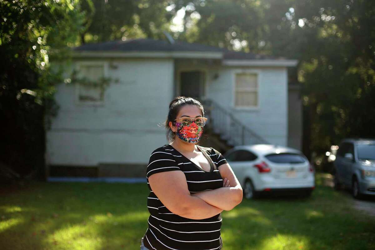 Gabrielle Luebano stands outside her home Tuesday. Residents in the buyout areas say they are confused, anxious and worried.