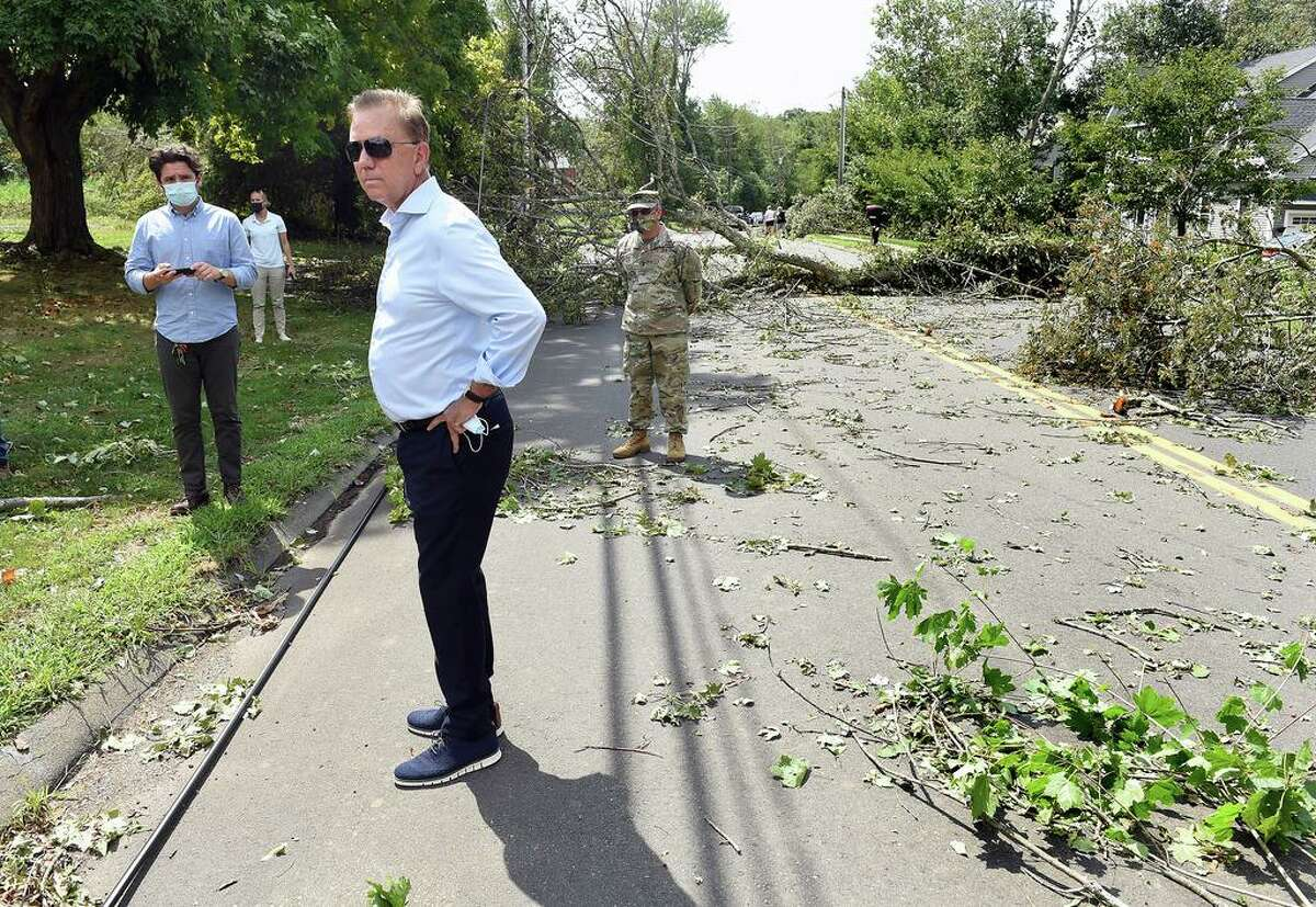 Governor Ned Lamont views downed trees blocking Damascus Road in Branford on August 28, 2020.