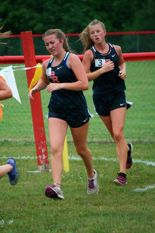 Zoey Deam and Oliviah Malloy of Big Rapids work on their pace on Friday at the Benzie Central Pete Moss Invitational. (Courtesy photo)