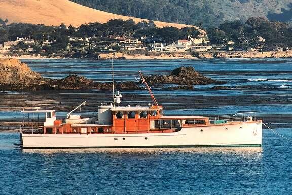 Yacht folly Ii anchored off pebble beach