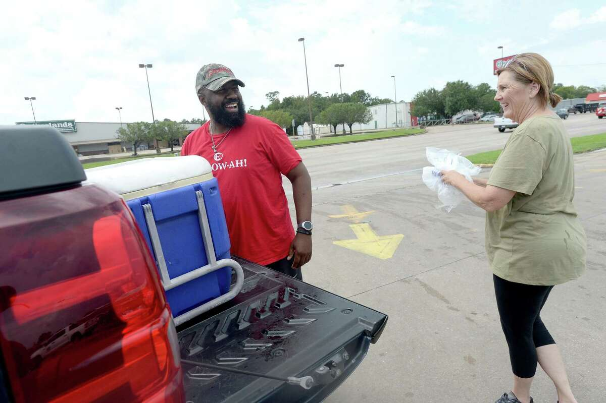 Keemani Cole thanks Peggy Lack after she gives him three bags of ice for free - the first to become available after she and husband Dale Lack got their ice house on College Street restarted. The couple evacuated first to their camp on the lakes, then after losing power, headed to Longview. They returned home to Port Neches Friday morning and were making stops at at their Beaumont ice houses to get them working now that power has been restored. They expect long lines later in the day onnce the machines are fully operational as thousands continue to face uncertain power outage durations. The Lack's are still living inn a trailer at home after their home was badly damaged in the TPC plant explosionn.