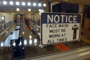 New signs with safety precautions are in place in the hallways of Johnson School, in Bridgeport, Conn. Aug. 27, 2020.