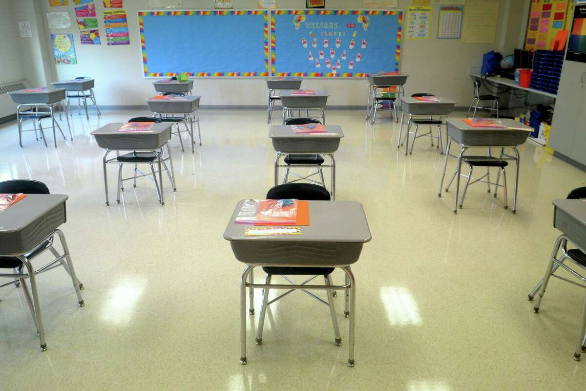 Desks are in place at a safe social distance in a classroom of Johnson School, in Bridgeport, Conn. Aug. 27, 2020. School districts are now deciding whether to offer remote learning in the 2021-22 school year.