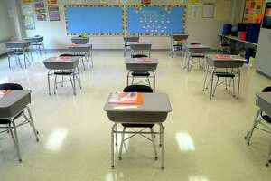 Desks are in place at a safe social distance in a classroom of Johnson School, in Bridgeport, Conn. Aug. 27, 2020.