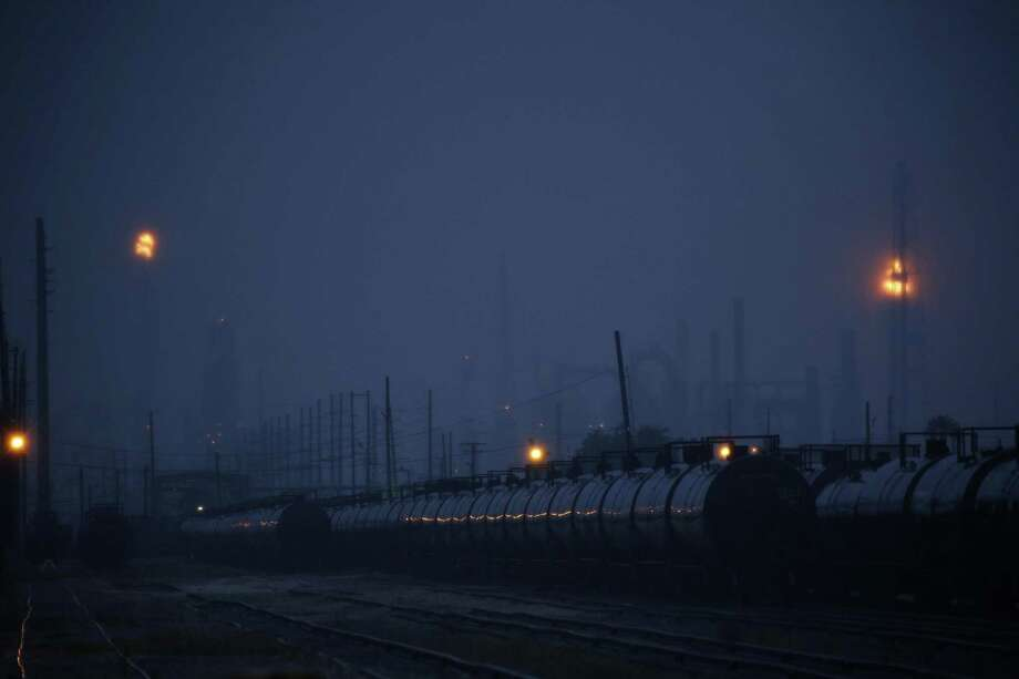 Rail tank cars sit parked near the Motiva Enterprises LLC Refinery ahead of Hurricane Laura in Port Arthur, Texas, U.S., on Tuesday, Aug. 25, 2020. Hurricane Laura is poised to become a roof-ripping Category 3 storm when it comes ashore along the Texas-Louisiana coast, threatening to inflict as much as $12 billion of damage on the region and potentially shutting 12% of U.S. refining capacity for months. Photographer: Luke Sharrett/Bloomberg Photo: Luke Sharrett / Bloomberg / © 2020 Bloomberg Finance LP