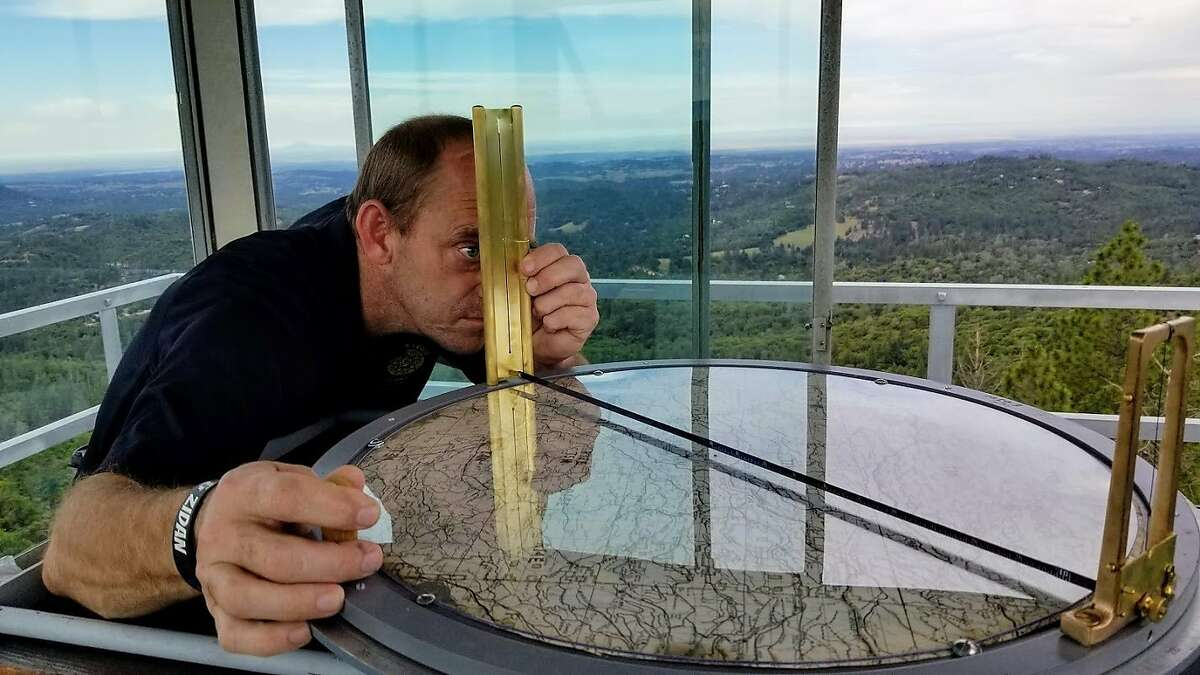 Volunteer fire-spotter Rich Martin uses an Osborne Fire Finder in the�Mt. Zion Lookout in Amador County.