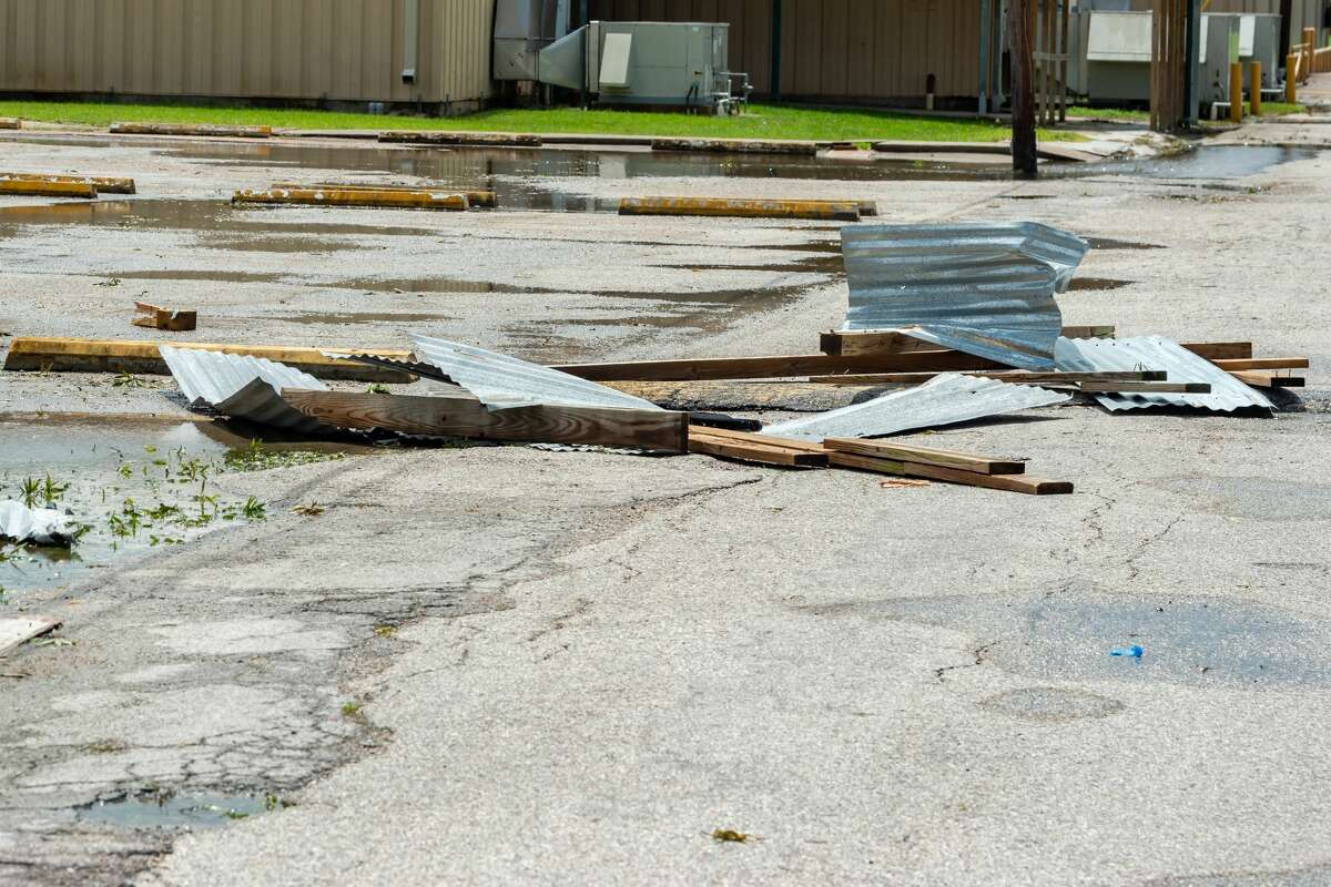 Pieces of metal roofing litter the campus of the high school from covered walkways, roofs, and outdoor covered areas. In addition to dealing with a number of fallen trees, Little Cypress-Mauriceville schools experienced storm damage at several of their facilities. Photo made on August 28, 2020. Fran Ruchalski/The Enterprise