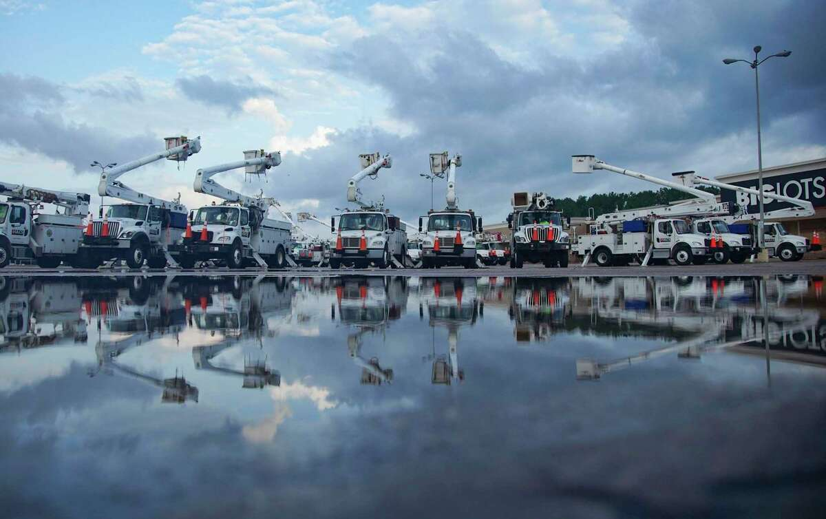 Utility trucks gather in Orange, Texas as recovery efforts continue following Hurricane Laura on Friday, Aug. 28, 2020.
