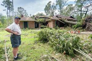 Bill Stark stands outside the house of his mother-in-law on Bear Path Road in Orange. He's living in the house now while he's building his new home. When the hurricane hit, he and his family went to sit on the back porch. They never even heard the tree crash into the front of the house. On Friday, the work of recovering from Hurricane Laura continued for many folks, some of whom had evacuated to avoid the storm. Photo made on August 28, 2020.  Fran Ruchalski/The Enterprise