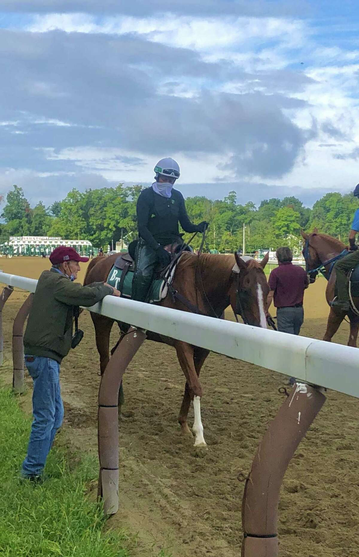 Trainer Barclay Tagg and his assistant Robin Smullen have a chat Friday morning on the backstretch at the Spa. Most likely, they were talking about when their stable star Tiz the Law is scheduled to have his final timed workout before the Kentucky Derby next Saturday. It looks as though the plan will be for the work to happen on Sunday morning when the expected rain is supposed to be out of here. (Tim Wilkin / Times Union)
