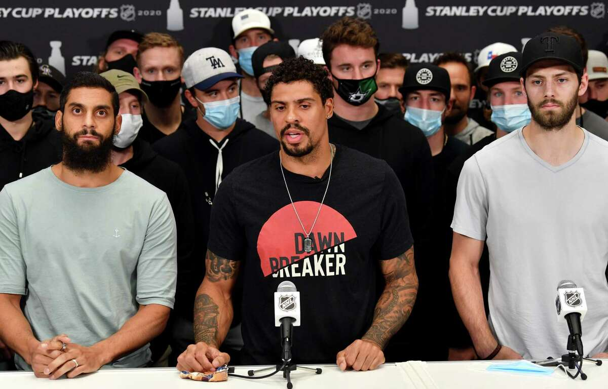 EDMONTON, ALBERTA - AUGUST 27: (L-R) Pierre-Edouard Bellemare #41 of the Colorado Avalanche, Ryan Reaves #75 of the Vegas Golden Knights and Jason Dickinson #18 of the Dallas Stars speak to the media with teammates standing behind after the NHL and NHLPA's announcement to reschedule the games of the Western Conference Second Round of the 2020 NHL Stanley Cup Playoffs at Rogers Place on August 27, 2020 in Edmonton, Alberta. Several sporting leagues across North America are postponing their schedules as players protest the shooting of Jacob Blake by Kenosha, Wisconsin police. (Photo by Andy Devlin/NHLI via Getty Images)