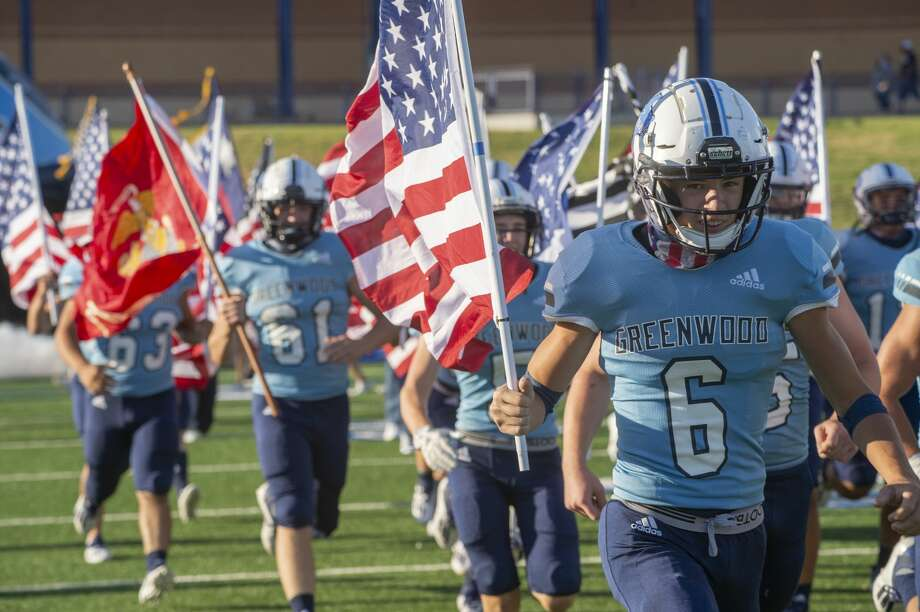 Greenwood players take the field continuing th tradition of carring American Flags as well as flags for each branch of the military 8/28/2020 at Grande Communications Stadium as they open the season against Estacado. Tim Fischer/Reporter-Telegram Photo: Tim Fischer/Midland Reporter-Telegram