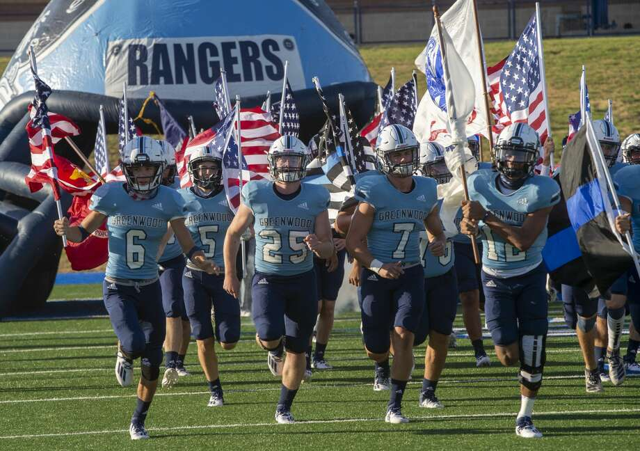 Greenwood players take the field 8/28/2020 at Grande Communications Stadium as they open the season against Estacado. Tim Fischer/Reporter-Telegram Photo: Tim Fischer/Midland Reporter-Telegram