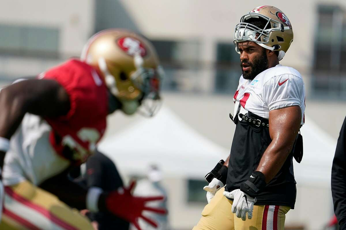 San Francisco 49ers linebacker Fred Warner (54) watches a drill during NFL football practice in Santa Clara, Calif., Sunday, Aug. 23, 2020.