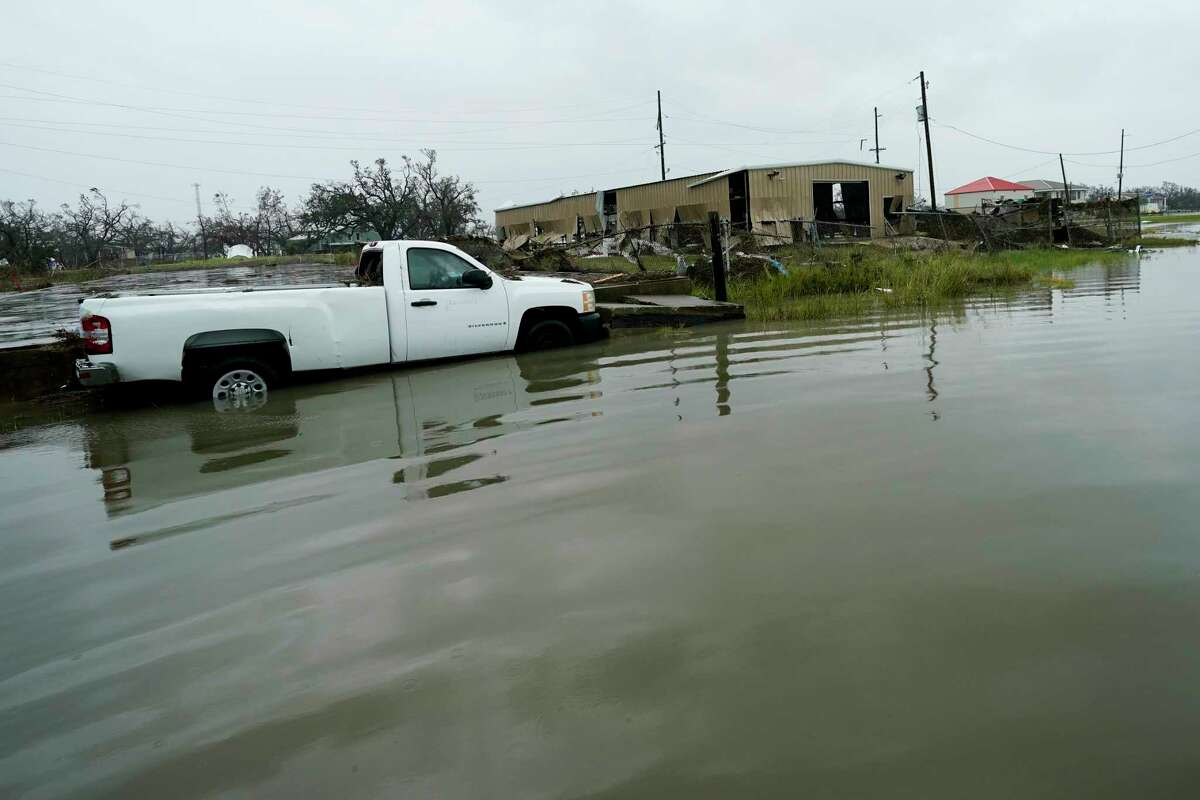 Foodwaters cover the street Friday, Aug. 28, 2020, in Cameron, La., after Hurricane Laura moved through the area Thursday. (AP Photo/David J. Phillip)