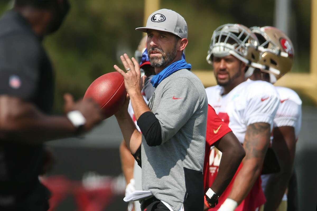 49ers head coach Kyle Shanahan throws the football during San Francisco 49ers 2020 Training Camp practice at SAP Performance Facility at Levi's Stadium on Monday, August 17, 2020 in Santa Clara, Calif.