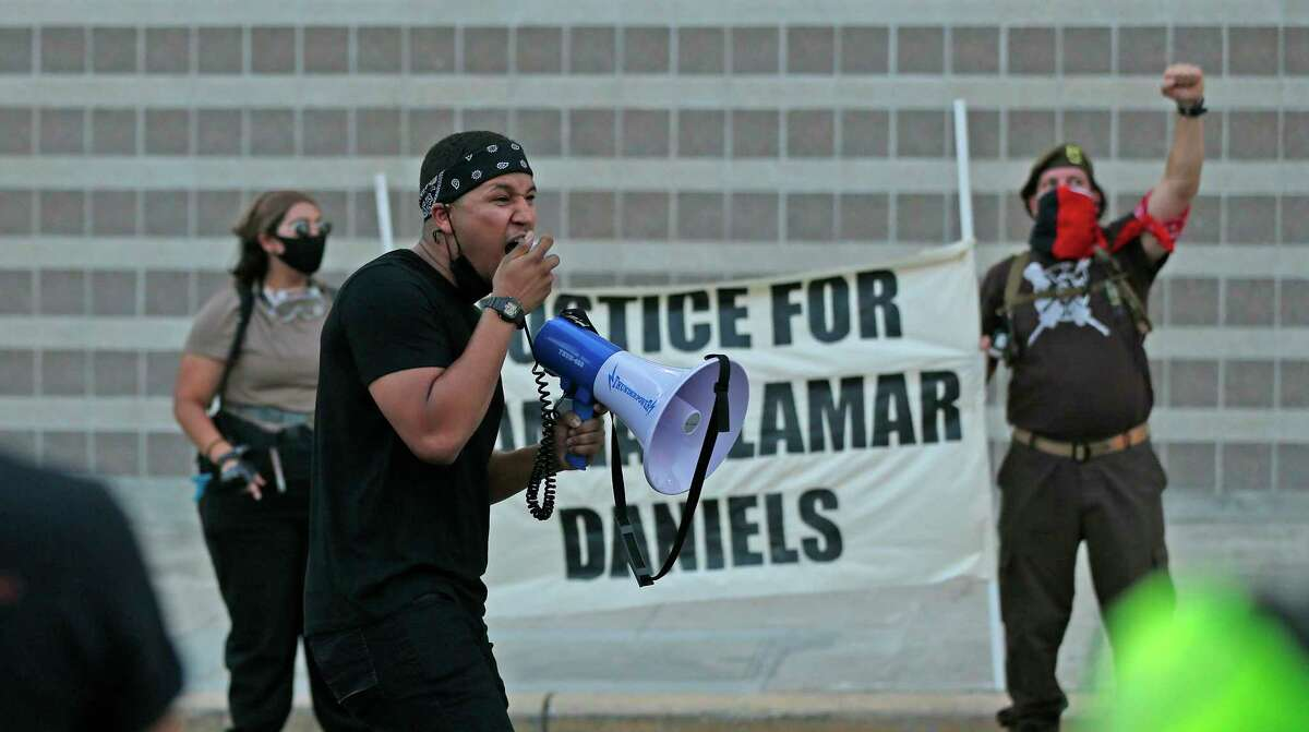 Jay Guiterrez fires up a crowd of about 50 people protesting the shooting death of Damian Lamar Daniels by a county deputy.