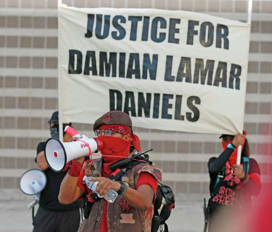 Protesters gathered near the Bexar County jail following Damian Lamar Daniels' fatal struggle with deputies. The tragedy underscores the need for reform. Photo: Ronald Cortes /Contributor / / 2020 Ronald Cortes