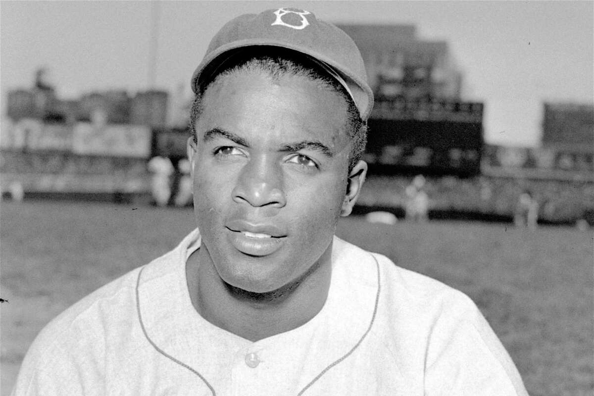 FILE - This is an April 18, 1948, portrait of Brooklyn Dodgers baseball player Jackie Robinson. It's Jackie Robinson Day across the big leagues on Friday, Aug. 28, 2020, as baseball honors the man who broke the sport's color barrier in 1947. (AP Photo/File)