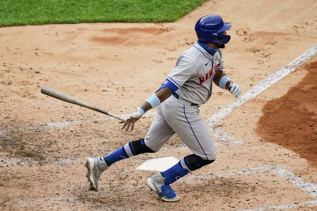 New York Mets' Dominic Smith hits a go-ahead solo home run off New York Yankees relief pitcher Chad Green in the sixth inning of the first baseball game of a doubleheader, Friday, Aug. 28, 2020, in New York. (AP Photo/John Minchillo)