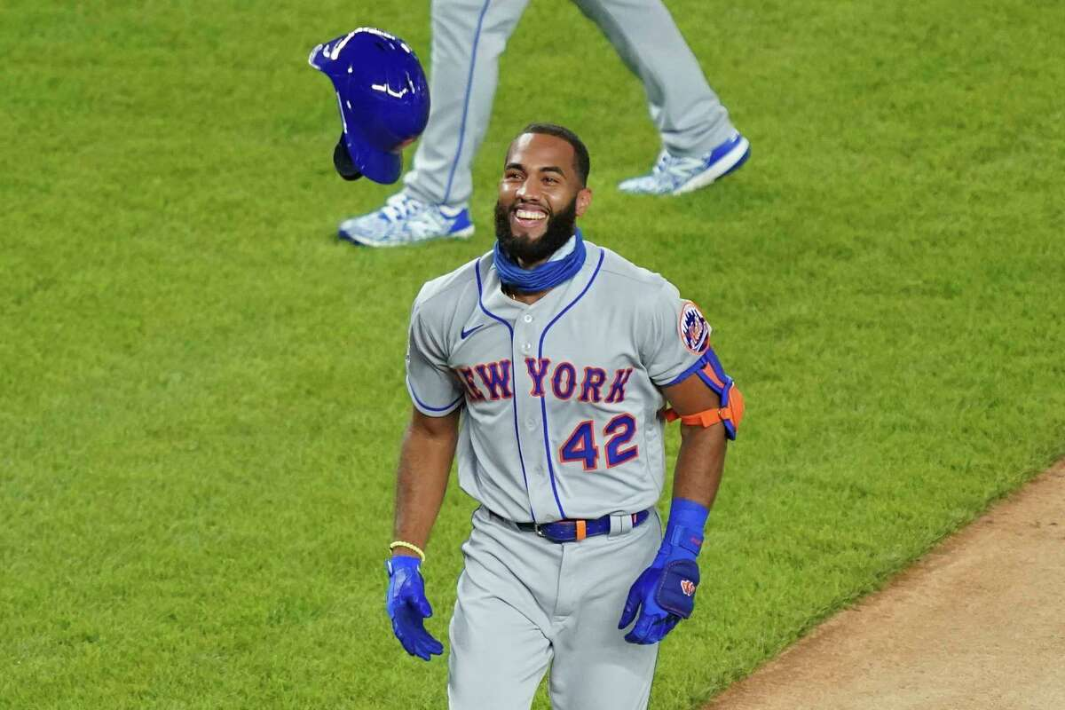 New York Mets' Amed Rosario runs the bases after hitting a walkoff home run off New York Yankees relief pitcher Aroldis Chapman in the seventh inning of the second baseball game of a doubleheader, Friday, Aug. 28, 2020, in New York. All players and management staff are wearing No. 42 as a tribute to baseball great Jackie Robinson. (AP Photo/John Minchillo)