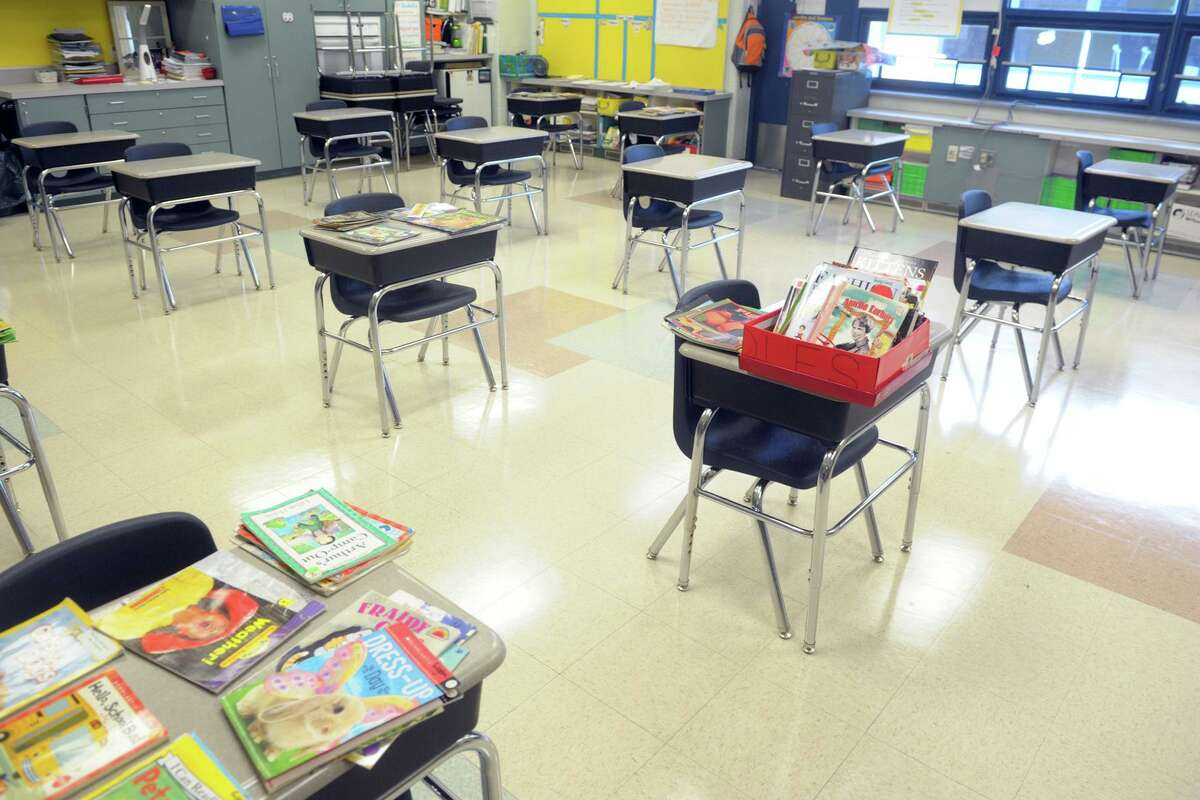 Desks are placed at a safe social distance in a classroom at Naramake School, in Norwalk.
