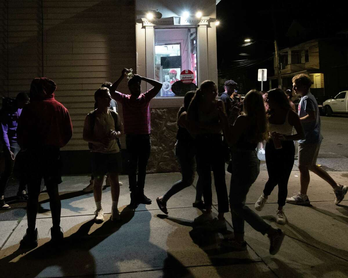 A crowd of UAlbany students gathers outside the Food Mart at the corner of Quail Street and Hudson Avenue in Albany, NY, on Friday, Aug. 28, 2020 (Jim Franco/special to the Times Union.)